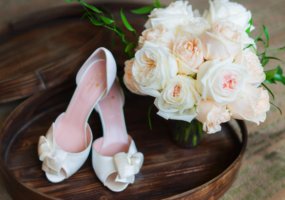 White rose bouquet and kate spade wedding shoes