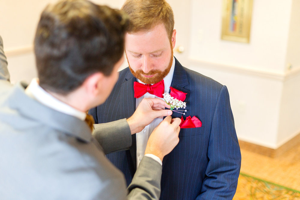 Groom getting his boutonniere pinned at The Bolger Center wedding