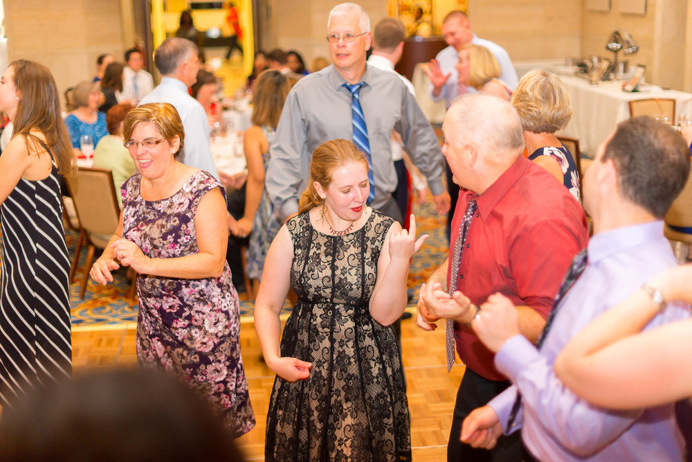 Guests playing air guitar at The Bolger Center wedding
