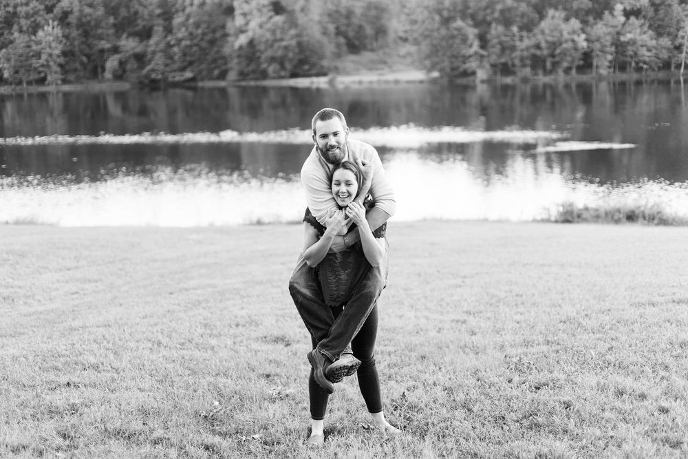 Piggy back engagement photos at Seneca Creek State Park by jessica nazarova