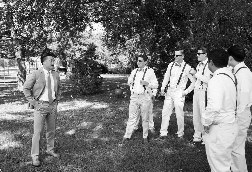 Groomsmen in suspenders in annapolis maryland wedding