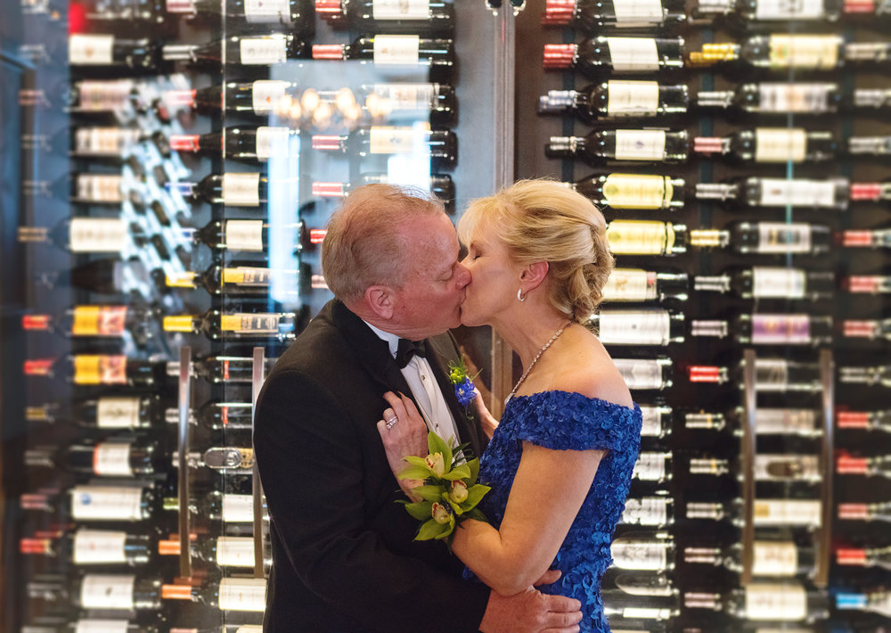 Bride and groom in front of the wine wall at a Ruths Chris in Gaitherburg MD