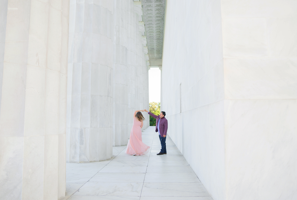 Dancing and twirling at the Lincoln memorial during cherry blossom festival engagement