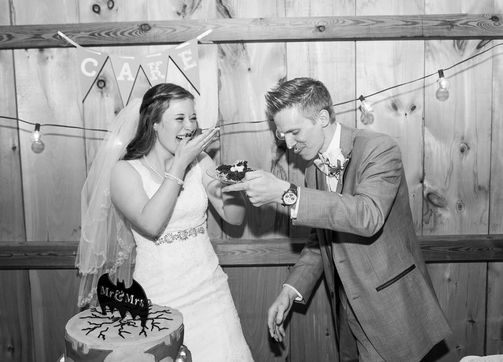 Bride and groom cutting cake at Steppingstone Museum Barn in winter