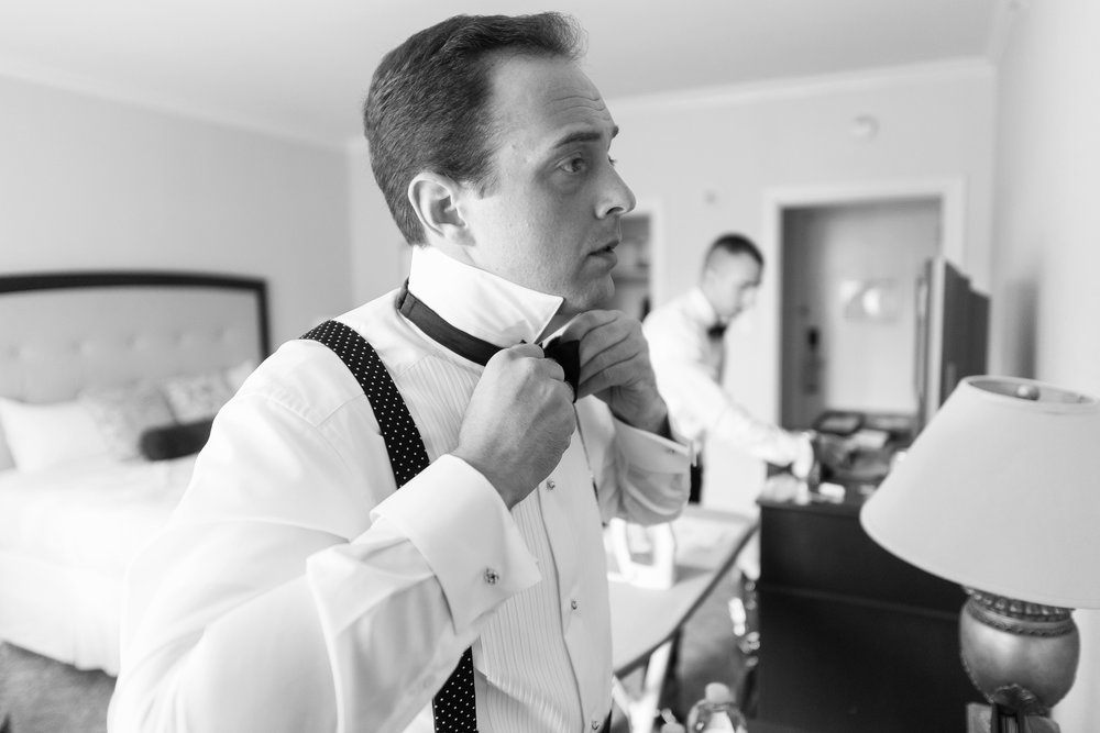 Groom getting ready at maryland hotel for cathedral wedding