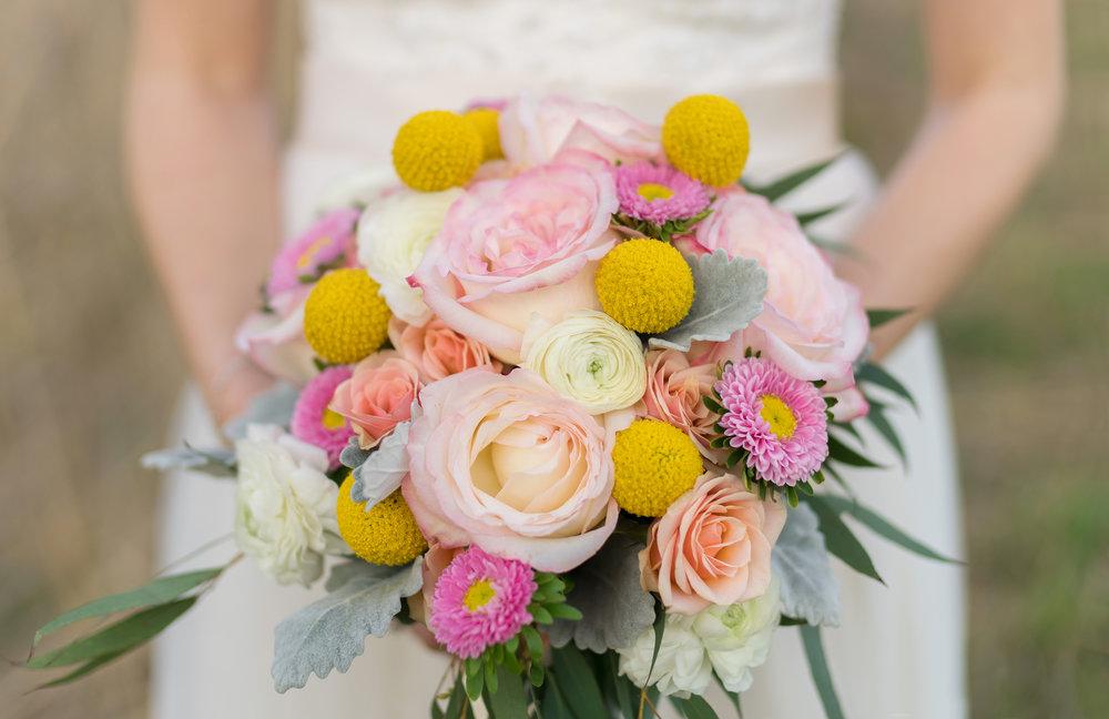 Craspedia and rose bouquet in Baltimore wedding