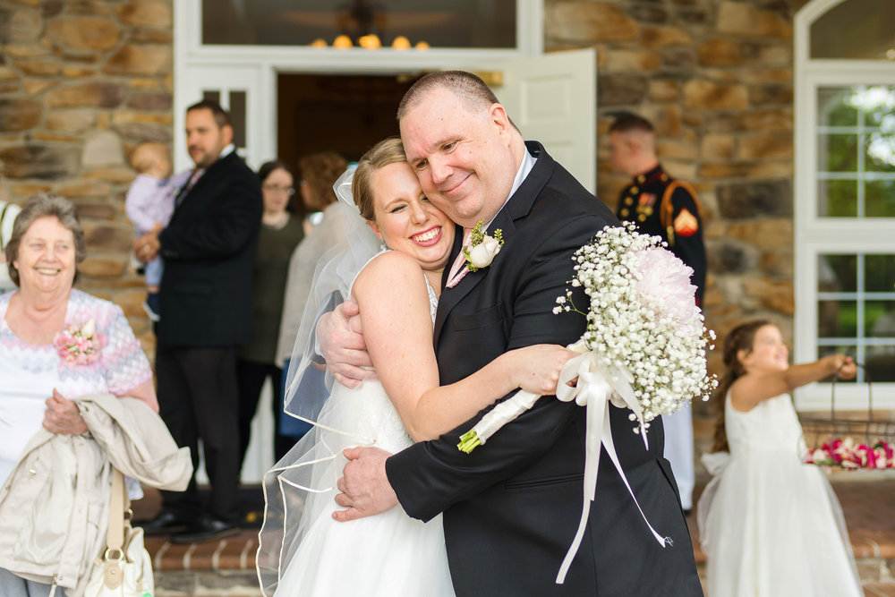 Bride and her father hug after the ceremony at Piedmont Golf Course