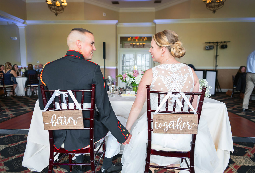 Better Together signs on the back of the brides and grooms chair at Piedmont