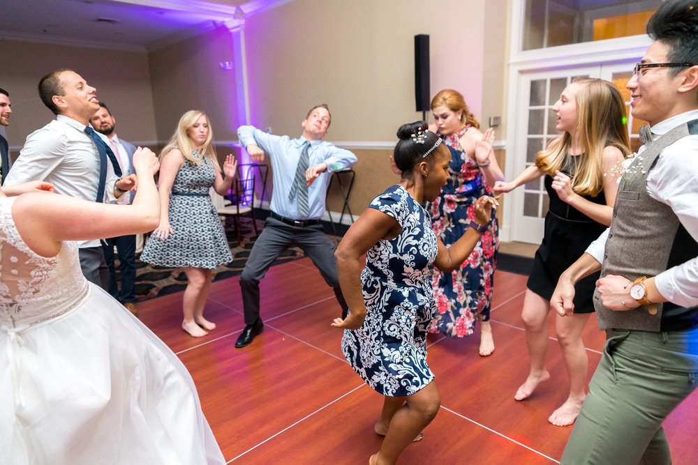 Guests dancing at night time wedding reception in Virginia