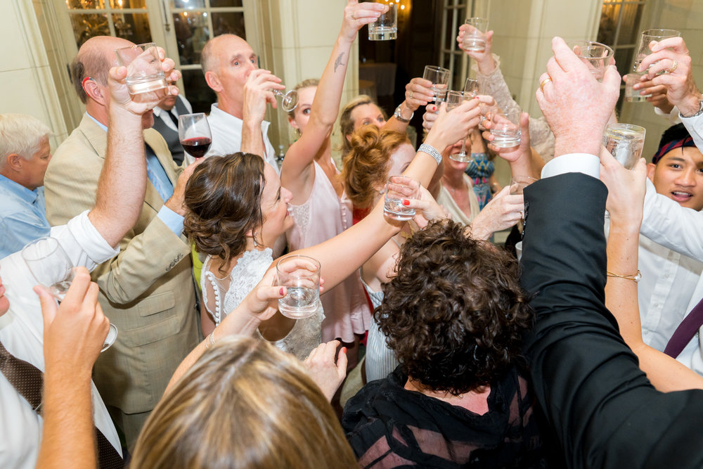 Toasts and shots at a wedding reception at meridian house