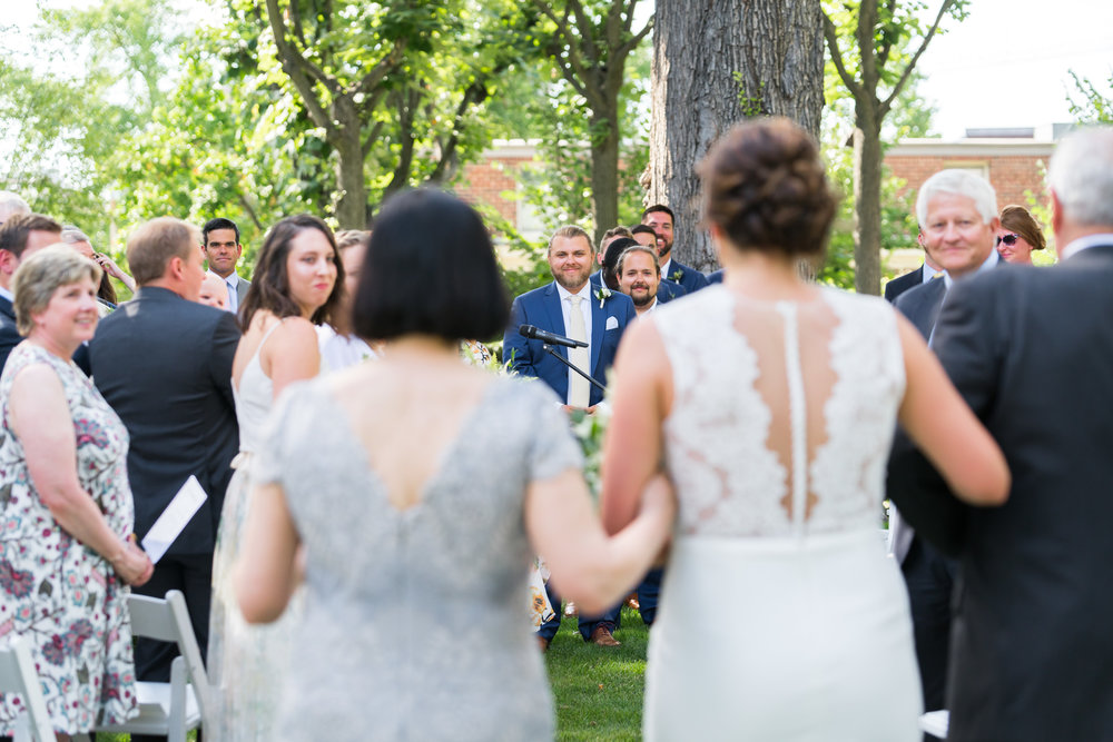 Bride walking down the aisle at meridian house ceremony