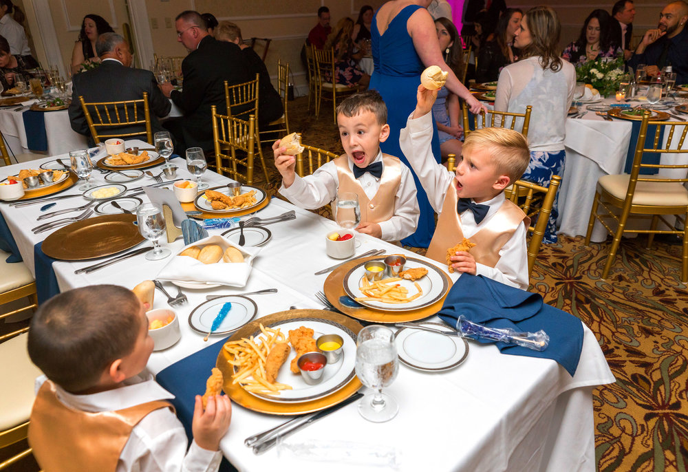 Hilarious kids eating chicken at Manor Country Club in Rockville wedding