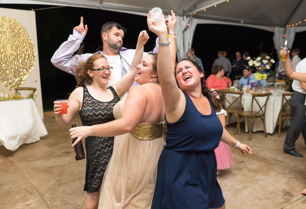 Bridesmaids and best friends dancing during the reception at Glen Ellen Farm