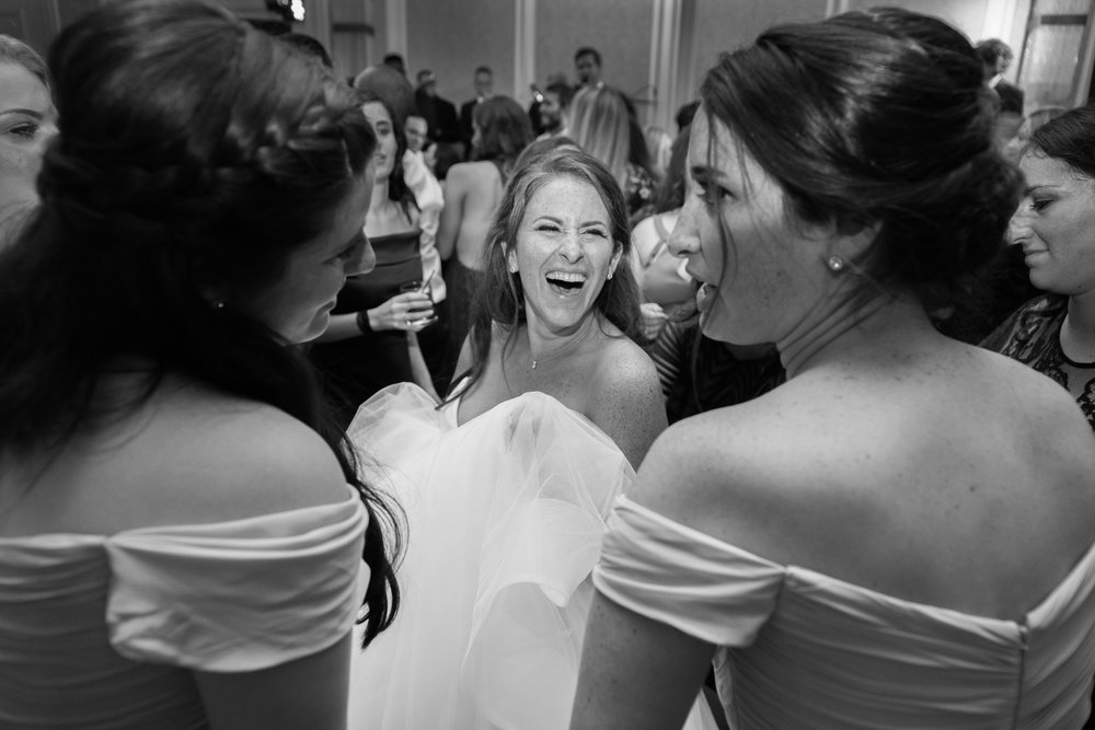 Bride and her sisters on the dance floor