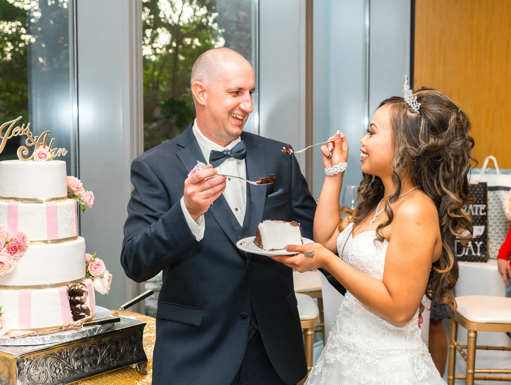 Bride and groom at 2941 feeding each other cake
