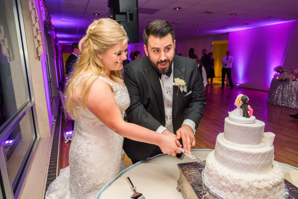 Cake cutting photos at Ft Belvoir wedding in virginia
