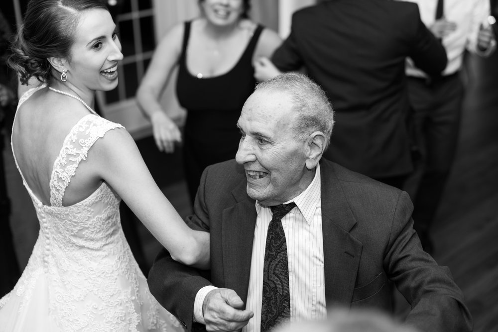 Black and white photo bride and grandpa dancing