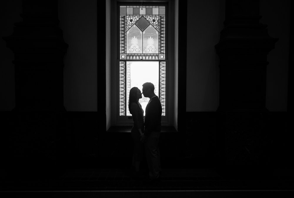 Black and white silhouette engagement photos at the Smithsonian museum