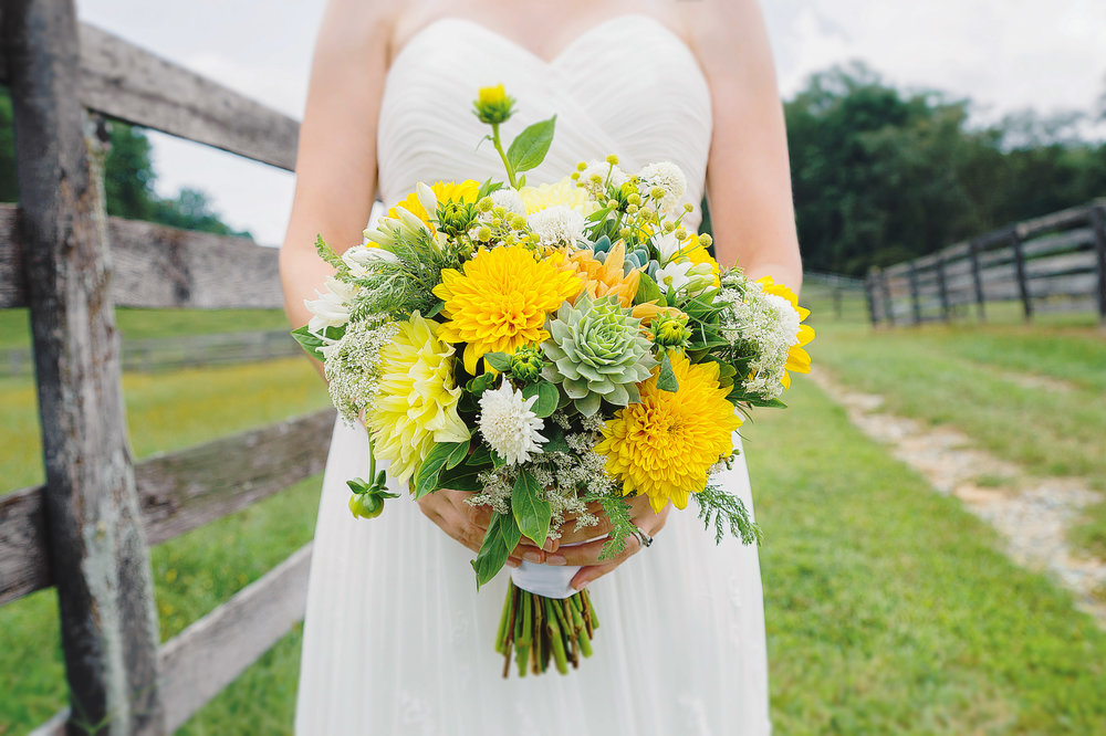 Succulent and yellow floral bouquet at Baltimore wedding by Jessica Nazarova