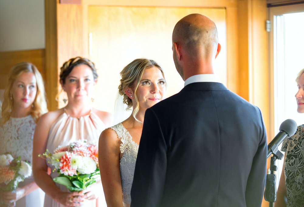Candid wedding photography bride looks at groom with tears