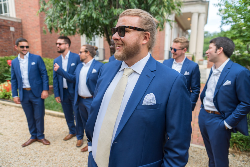 Groom and groomsmen in blue suit at a DC wedding