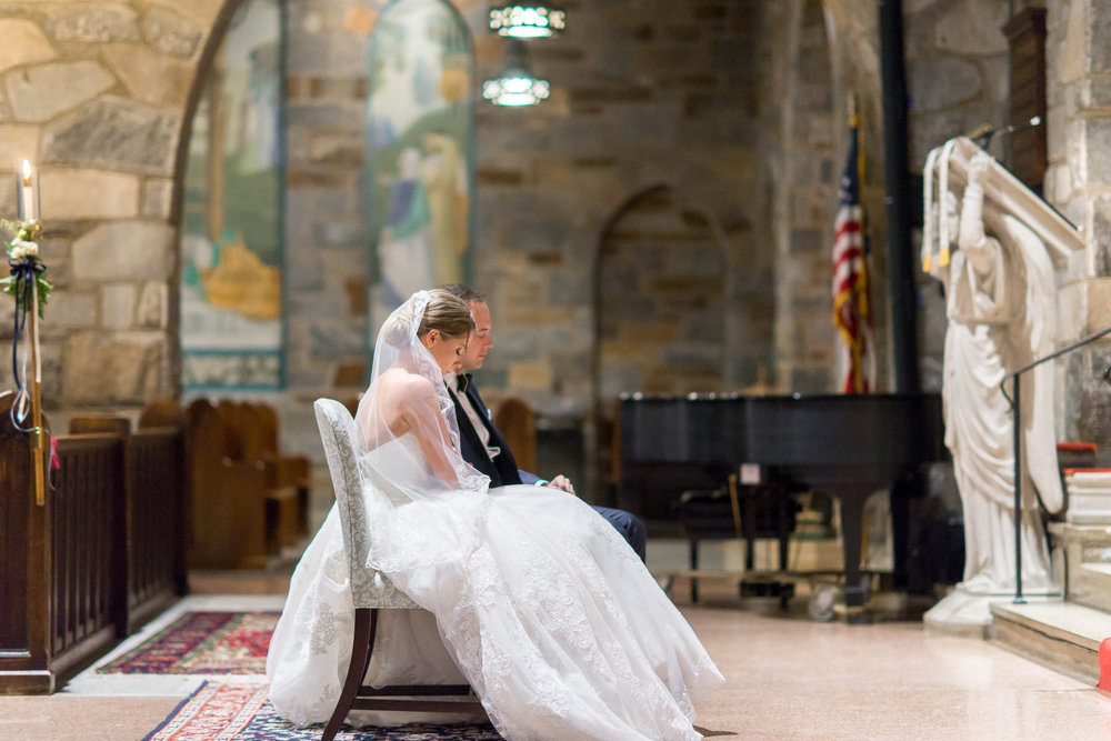 Bride and groom portraits at all saints church wedding in bethesda maryland