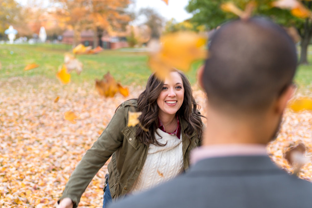 Throwing leaves at each other in Frederick Maryland engagement session