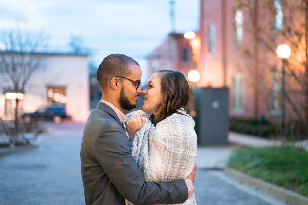 Nighttime engagement session in an alleyway in frederick