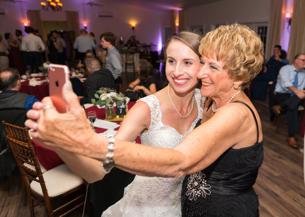 Bride and grandma taking a selfie at Harvest House