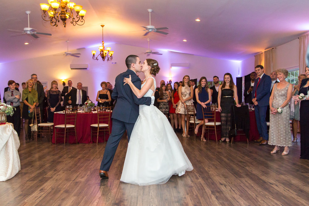 Bride and groom share their first dance at Harvest House