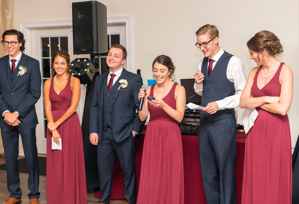 Bridal party reading their toasts Lost Creek Winery
