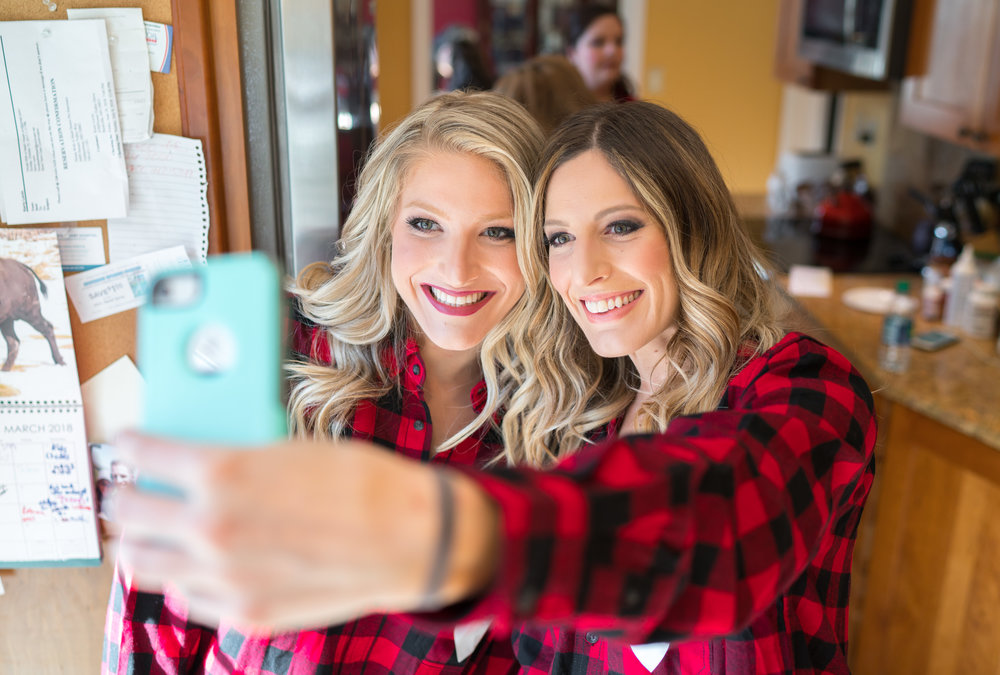 Bridesmaids in lumberjack shirts getting ready