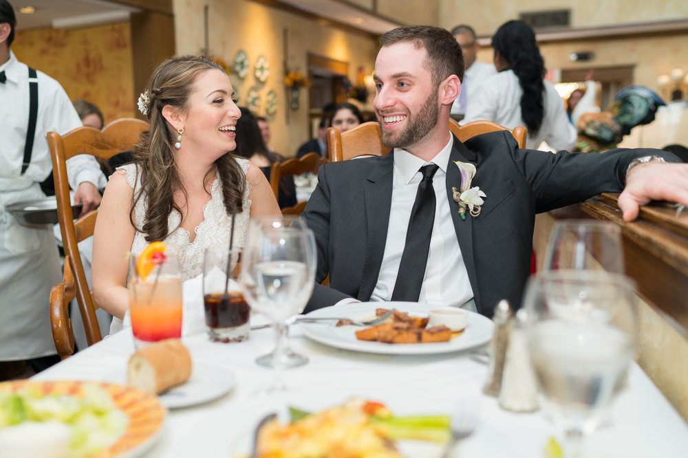 Laughing at the toasts at La Ferme wedding reception