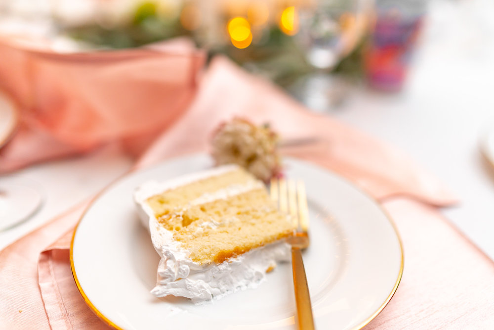 Yellow cake and white frosting and rose gold details at Hendry House wedding