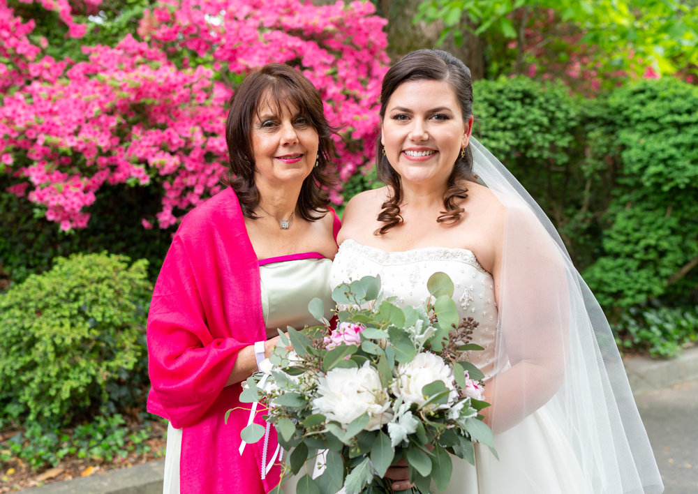 Bride and her mother in front of pink azaleas at Hendry House wedding