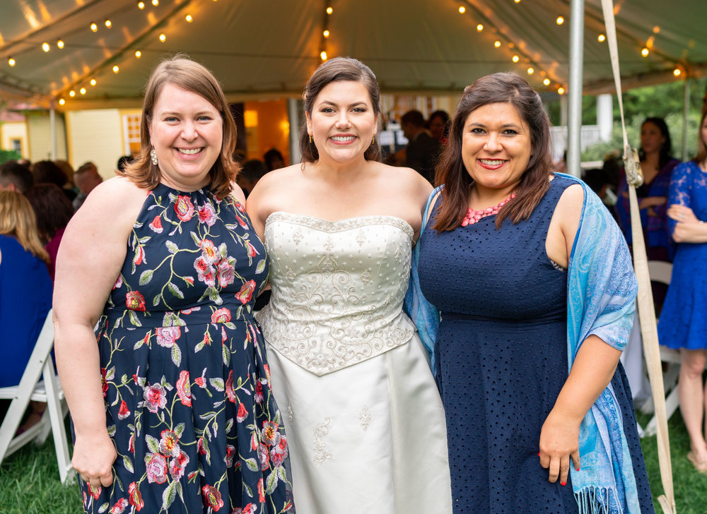 Bride and her friends under tent reception at Hendry House wedding