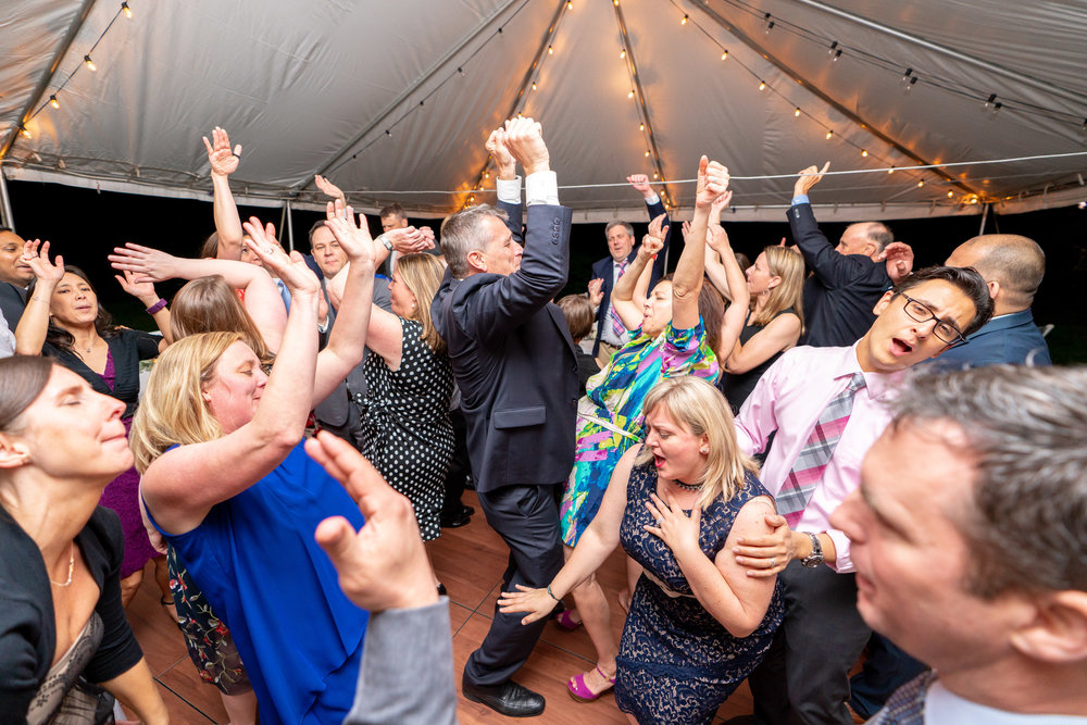 Amazing shot of guests hands in the air at crazy wedding reception at Hendry House