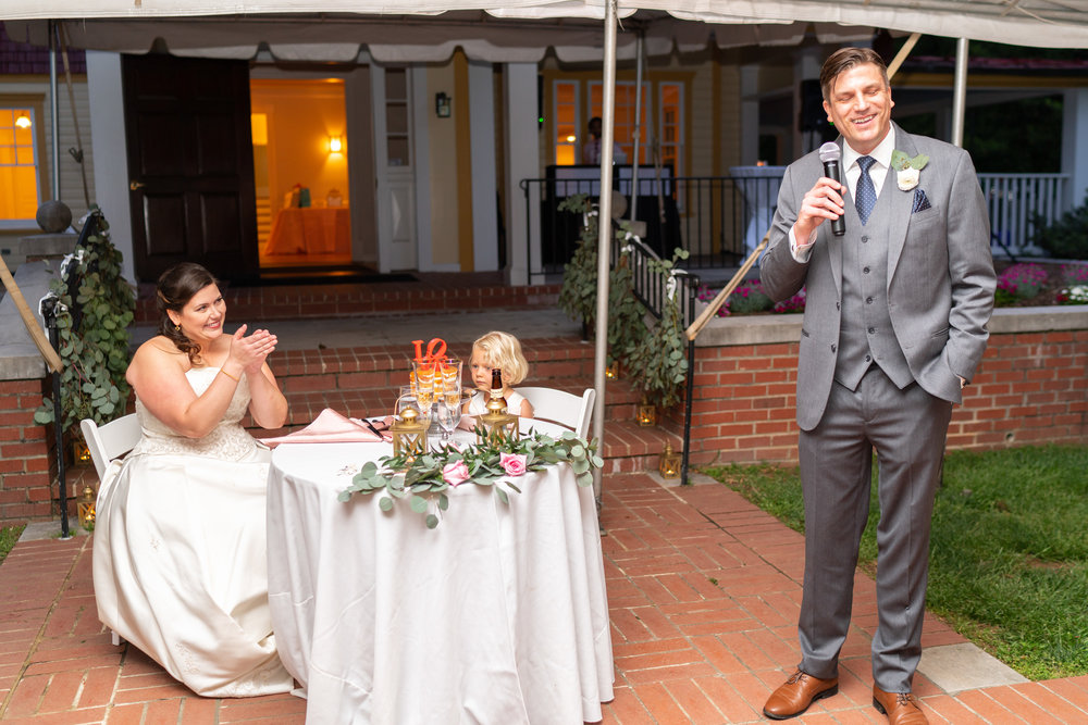Groom giving a toast at Hendry House tented wedding reception