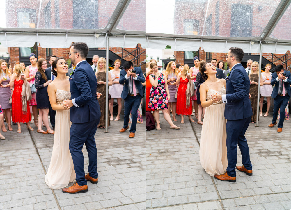 Bride and groom laugh while sharing first dance under clear tent reception at DC venue Gallery OonH