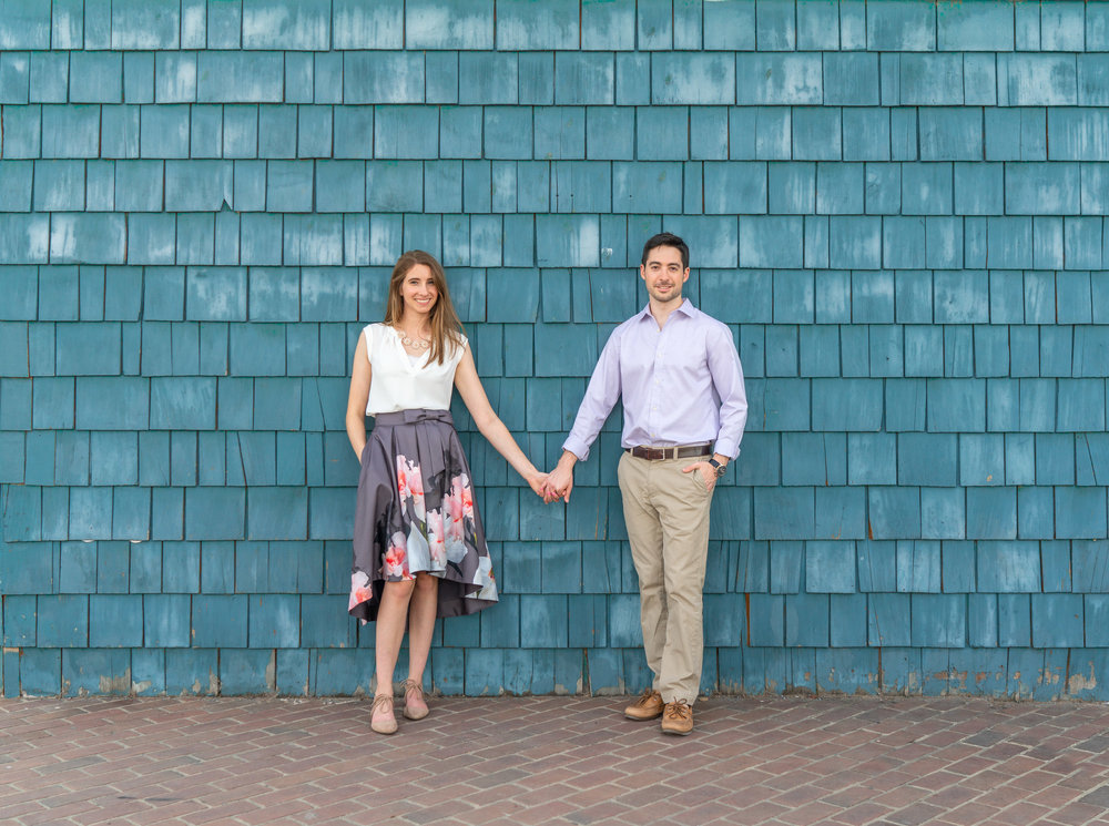 Engagement photo in front of the Chart House restaurant on Alexandria Virginia