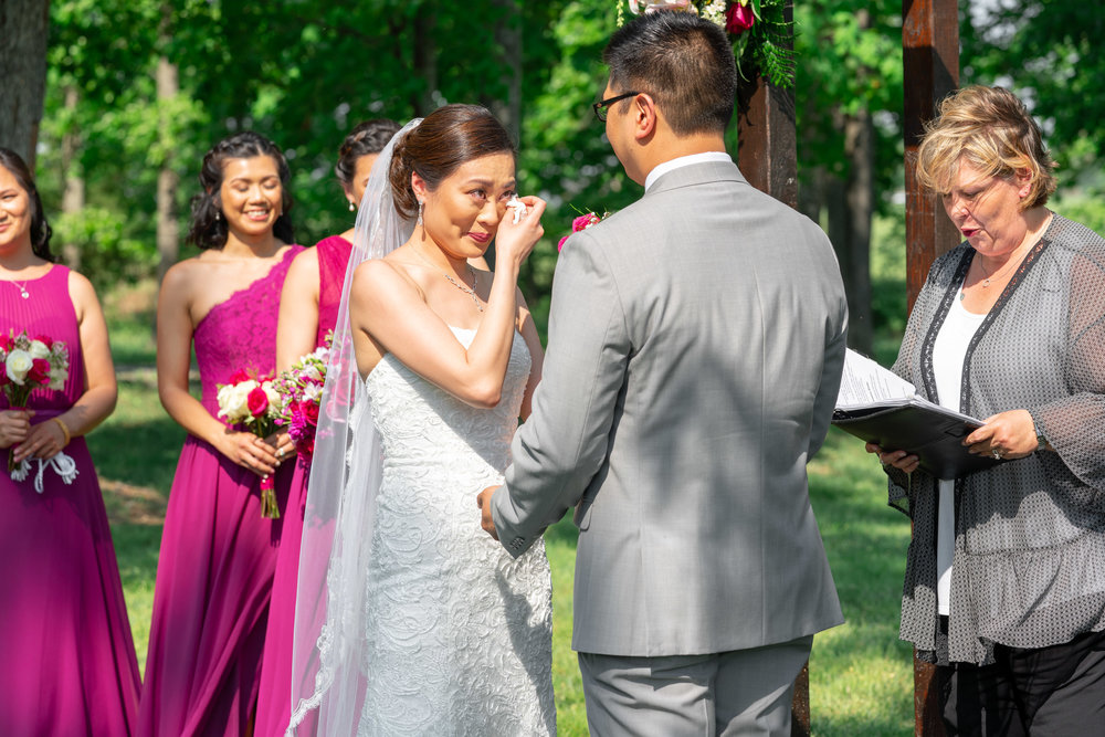 Bride crying at vineyard ceremony at Harvest House Lost Creek Winery