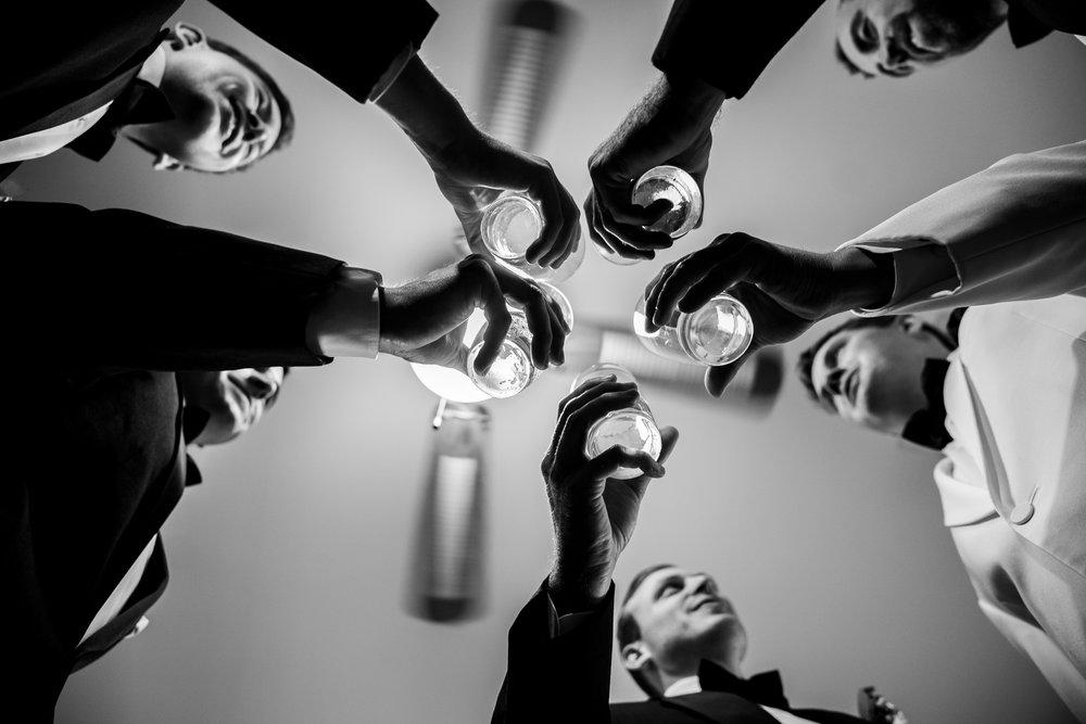 Groom and groomsmen toasting at Harvest House wedding in Leesburg