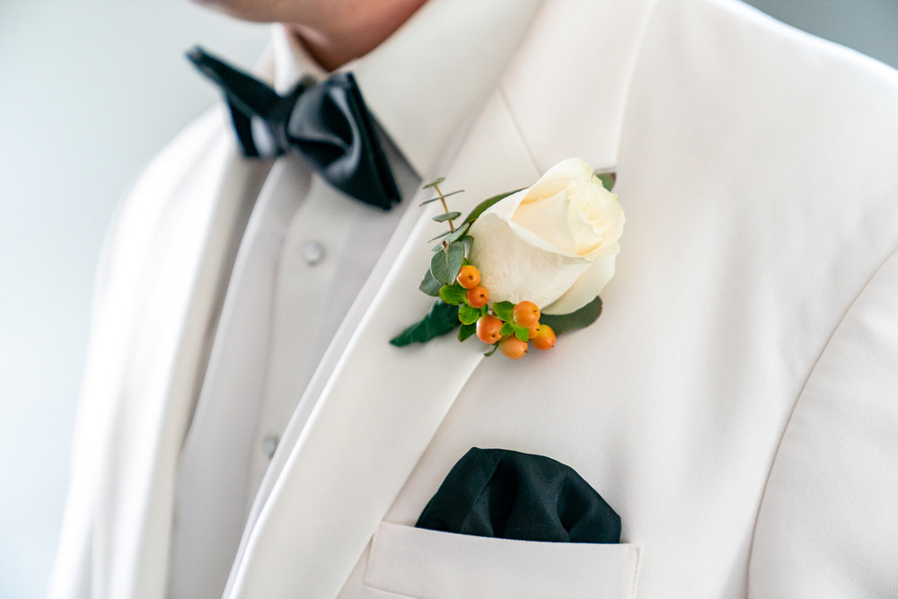 White groom's tux and white rose boutonniere at Lost Creek Winery wedding