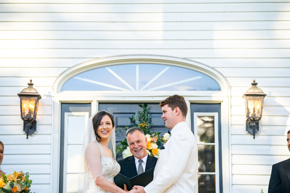 Bride and groom smiling and facing guests at Lost Creek Winery