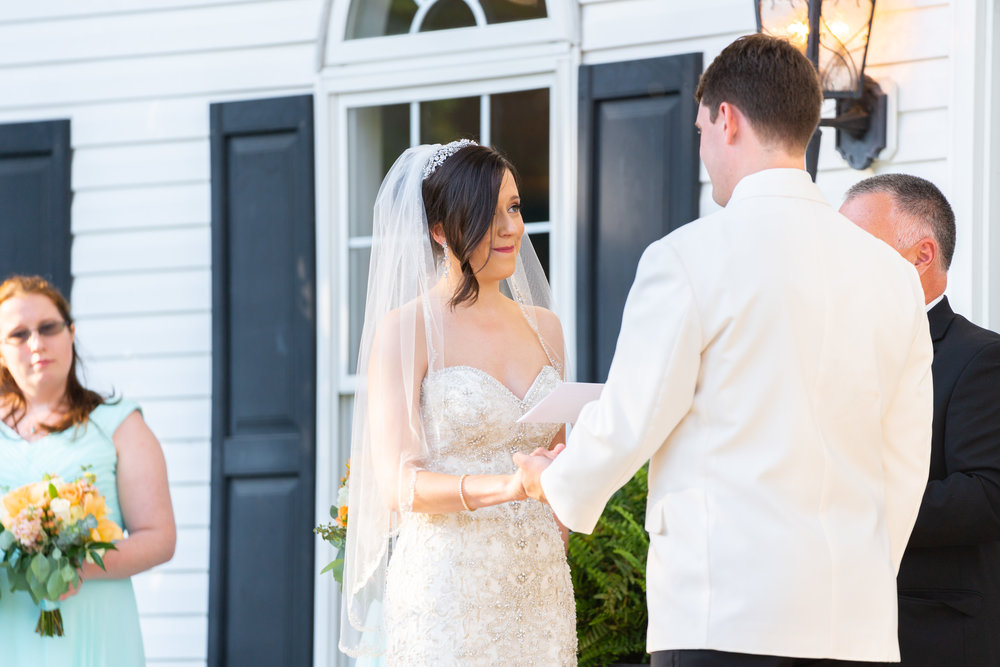 Bride reading vows at Harvest House at Lost Creek Winery