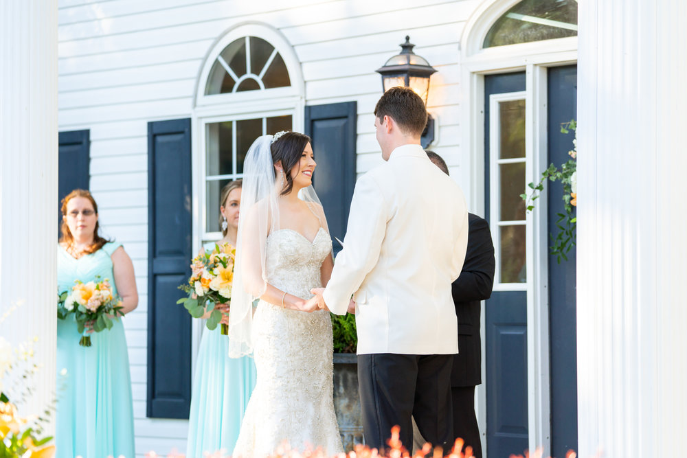 Bride and groom in front of blue door at Harvest House wedding