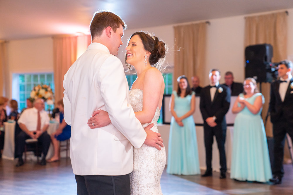 Bride and groom having their first dance at Harvest House