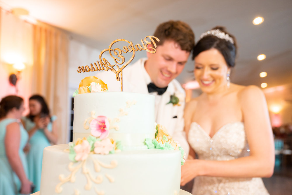 Wedding cake cutting at Harvest House Lost Creek Winery