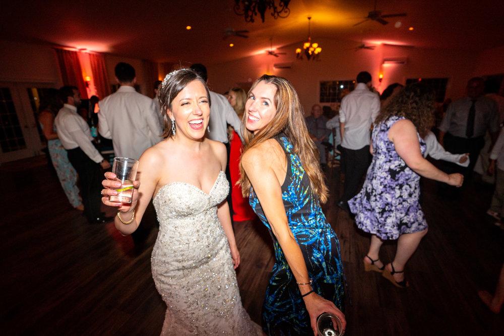 Bride and wedding guest dancing at Lost Creek reception hall