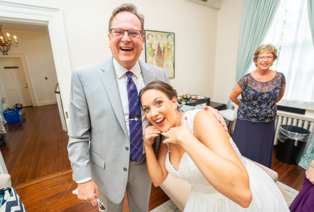 Bride and her dad at Rust Manor House bridal suite posing